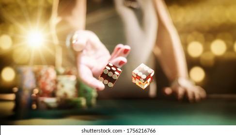 Woman gambling at the craps table at the casino - Selective focus