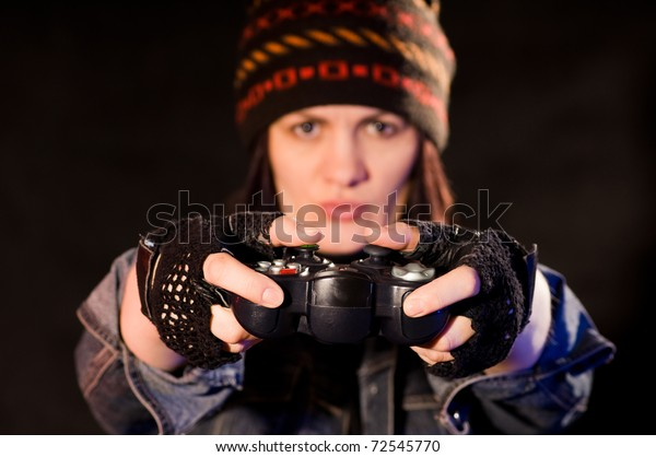 woman gamer with joystick  on darken background
