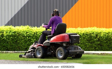 Woman with garden lawn mower