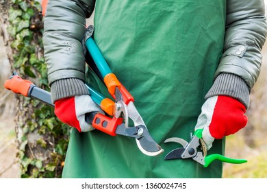 Woman gardener with scissors