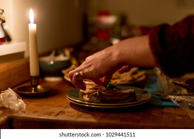 Woman Garnishing Cold Dinner with Green Herb