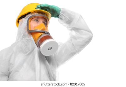 Woman in gas mask and bio-hazard suit on white background.