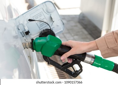 Woman at the gas pump station
