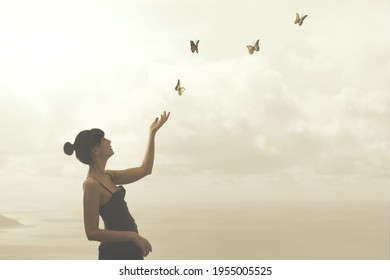 woman gently touches free flying butterflies