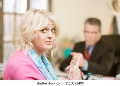 Woman gesture towards incompetent male colleague
