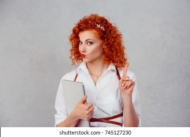 woman gesturing a no sign. Closeup portrait unhappy, serious red head retro style girl raising wagging finger up saying oh no you did not do that do not touch my laptop isolated on gray background