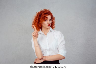 woman gesturing a no sign. portrait unhappy, serious redhead curly retro style girl raising finger up saying oh no you did not do that gray grey background. Negative emotions facial expression feeling