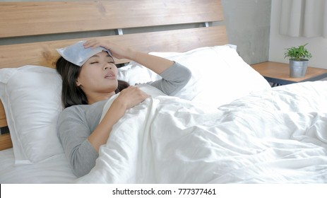 woman get sick and fever lying on the bed