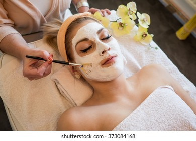 Woman gets a beauty face mask