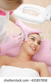 Woman gets injection in her face. Beauty woman giving botox injections. Young woman gets beauty facial injections in the cosmetology salon. Face aging injection. Aesthetic Medicine, Cosmetology