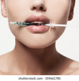 woman gets an injection in her lips. increase the lips by hyaluronic acid