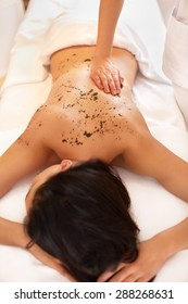 Woman Gets a Marine Algae Wrap Treatment in Spa Salon
