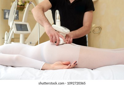 Woman getting anti cellulite and anti fat therapy in beauty salon. The masseur make an anti-cellulite massage