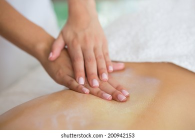 Woman getting a back massage at the health spa