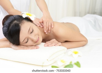 Woman getting a body massage.