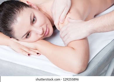 Woman getting body massage at spa salon