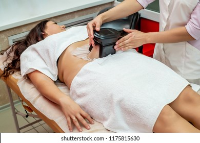 Woman getting cryolipolysis fat treatment procedure in professional cosmetic cabinet or spa center