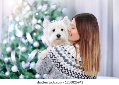 Woman getting a dog as a christmas gift