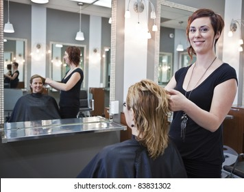 Woman getting a haircut at a beauty salon