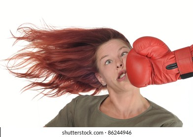 woman getting a hard punch from boxing glove fist