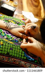 Woman getting a henna tattoo painted on her hand at a market in Chiang Mai, Northern Thailand, Southeast Asia