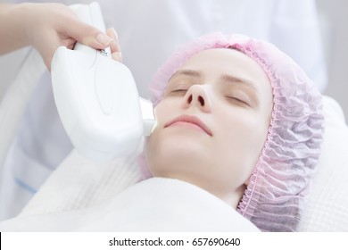 Woman getting laser face treatment in medical spa center, skin rejuvenation concept, Laser removal of acne, vessels