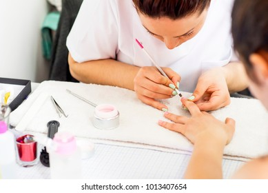 Woman getting a manicure at the beauty salon