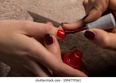 Woman getting manicure nail paint color at salon