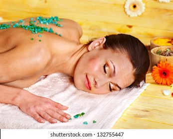 Woman getting  massage body salt scrub.