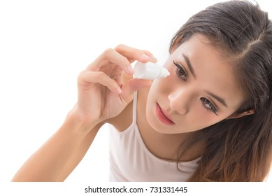 woman getting the medicine in the eye.Young woman applying eye drops isolated on white background. Health care concept.