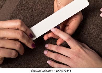 Woman getting nail manicure