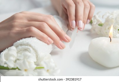 Woman getting nail manicure. Close up, selective focus.