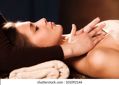 woman getting neck  massage in spa