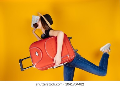 woman getting ready to go on a trip on a yellow background