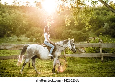 Woman getting ready for horseback riding