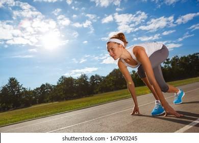 Woman getting ready to start on Stadium - summer outdoors training.