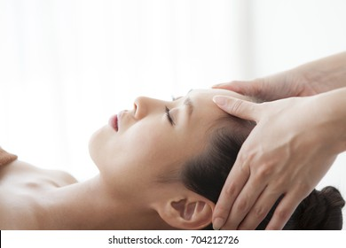 Woman getting a getting relaxing massage in salon.