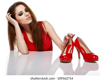 Woman getting shoes of her shopping.