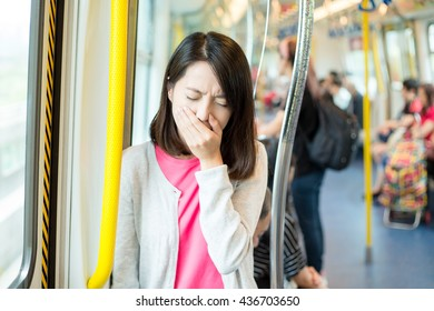 Woman getting sick in train compartment