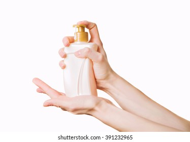 Woman getting soap from a dispencer. Hands with liquid pumping lotion