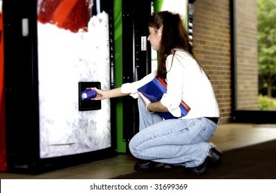 Woman getting soda from vend machine