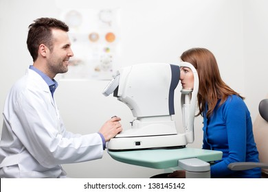 Woman getting visual field test done by the optometrist