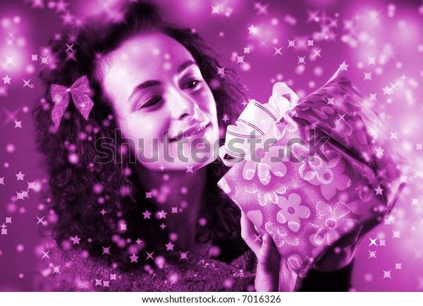 woman with a gift in her hands and snowflakes