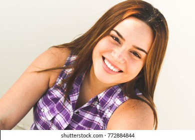 Woman with ginger hair, cheerful model with ginger hair