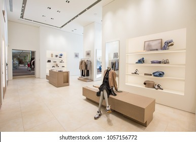 woman girl clothing and accessories luxury store  interior