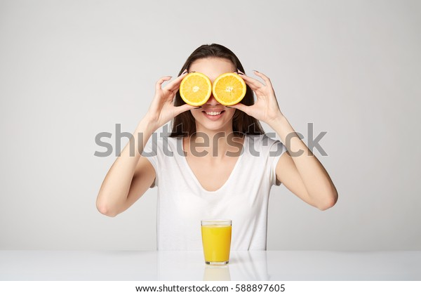 woman girl with fruits on gray white background