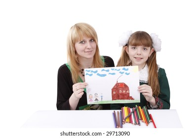 Woman and girl are holding the picture. Mother and her young daughter drawing together. Girl is painting her family in bright colours. Isolated over white background.