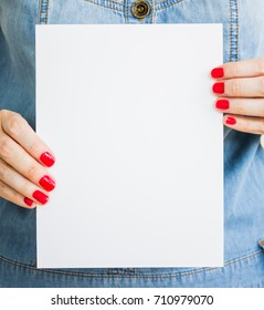 Woman, girl holds blank white paper. Mockup of the Leaflet, announcement, presentation. Sheet template