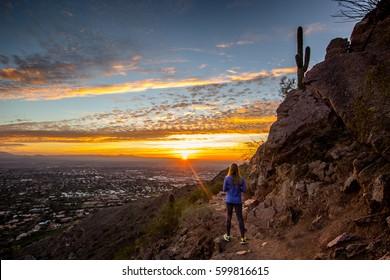 Woman or girl watching sunrise in Phoenix, Arizona