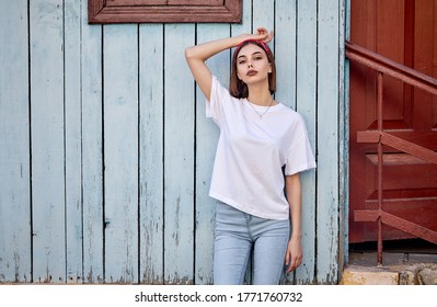 Woman or girl wearing white blank t-shirt with space for your logo, mock up or design in casual urban style